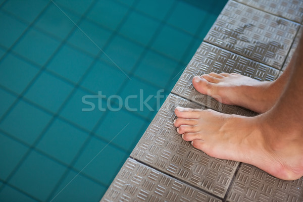 Close up low section of barefeet by pool Stock photo © wavebreak_media