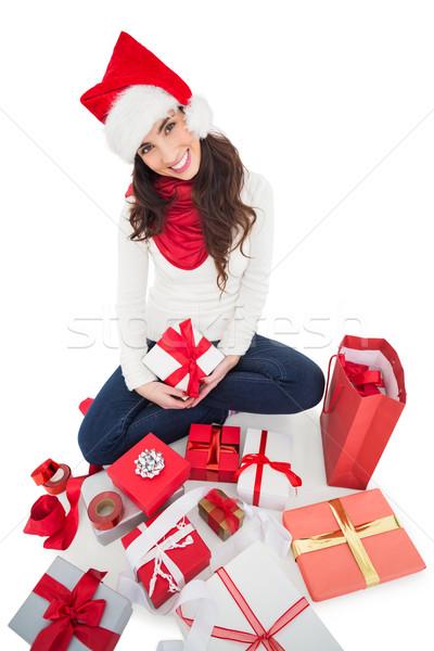 Festive brunette sitting and wrapping christmas presents  Stock photo © wavebreak_media