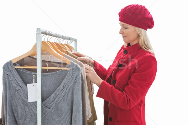Pretty blonde looking at clothes on rail Stock photo © wavebreak_media