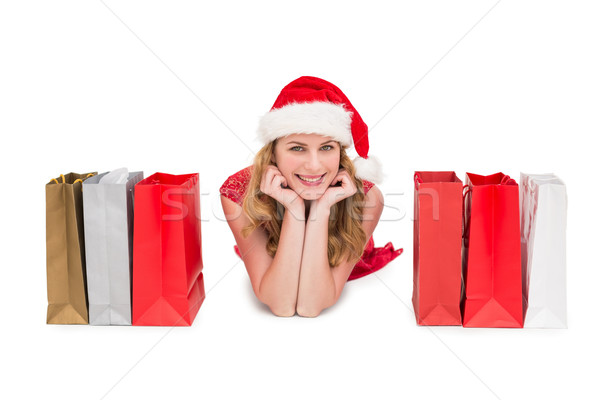 Smiling woman lying between shopping bags Stock photo © wavebreak_media