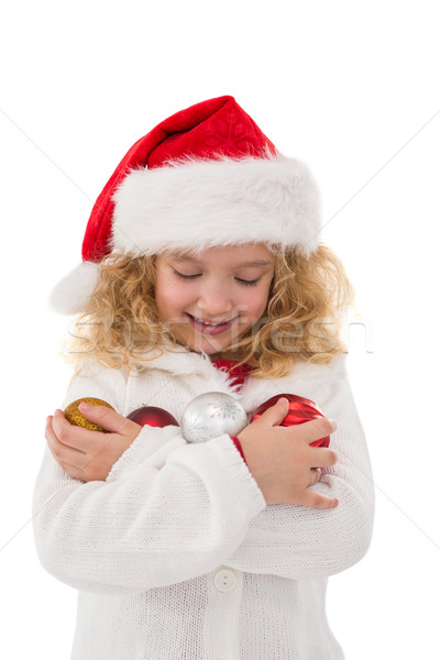 Festive little girl holding baubles Stock photo © wavebreak_media