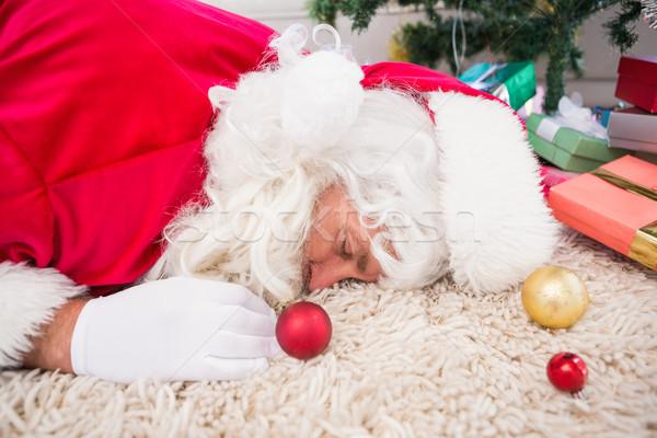 Exhausted santa resting on the rug  Stock photo © wavebreak_media