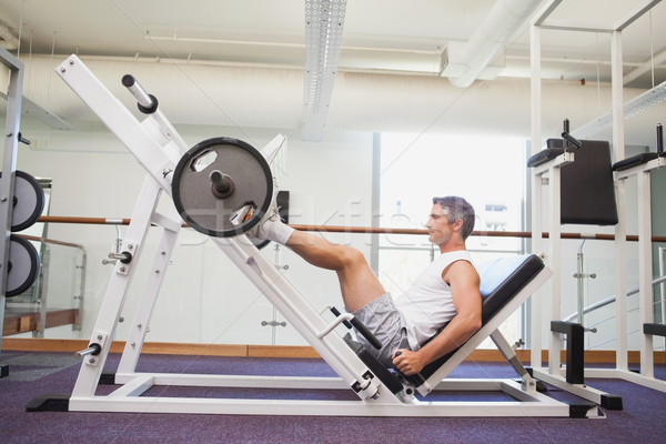 Fit man lifting heavy barbell with legs Stock photo © wavebreak_media