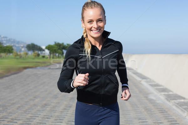 Fit blonde jogging on the pier Stock photo © wavebreak_media