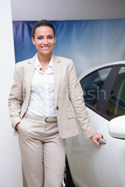 Smiling businesswoman holding a car door handles Stock photo © wavebreak_media