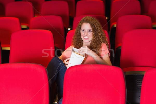 Mulher jovem assistindo filme cinema filme cadeira Foto stock © wavebreak_media