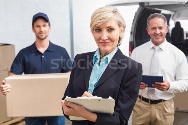 Glimlachend manager collega's groot Stockfoto © wavebreak_media
