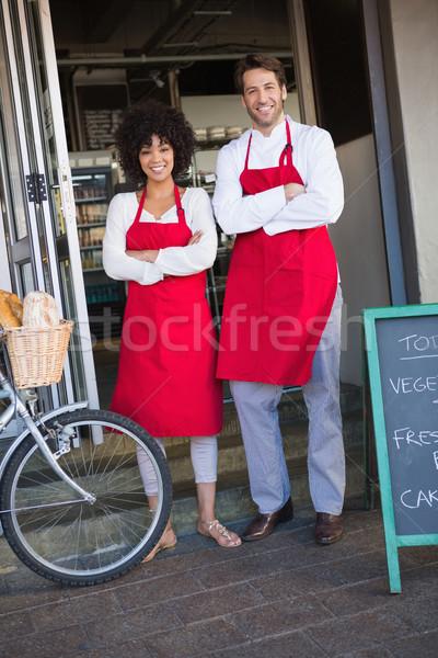 Portret gelukkig collega's Rood schort poseren Stockfoto © wavebreak_media