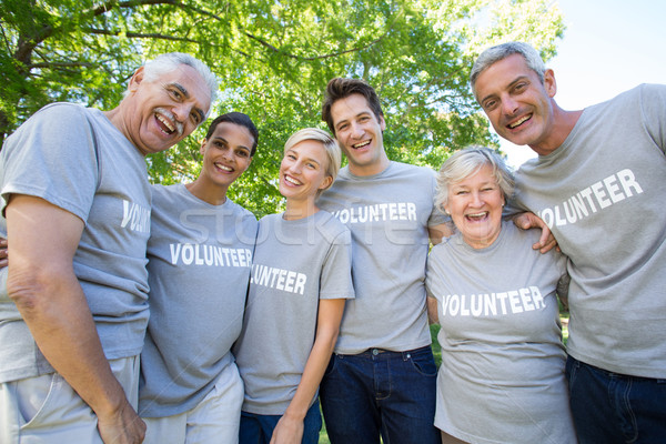 Happy volunteer family smiling at the camera Stock photo © wavebreak_media