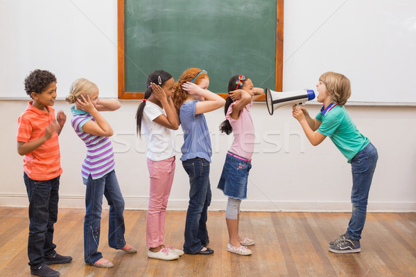 Cute pupil shouting in classroom  Stock photo © wavebreak_media