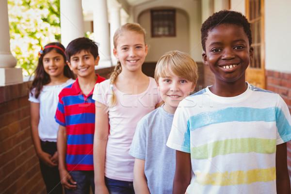 笑みを浮かべて 学校 子供 廊下 肖像 ストックフォト © wavebreak_media