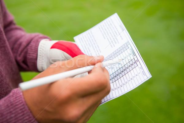 Golfista iscritto punti carta campo da golf Foto d'archivio © wavebreak_media
