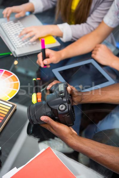 Criador pessoas de negócios câmera digital mesa de escritório negócio Foto stock © wavebreak_media