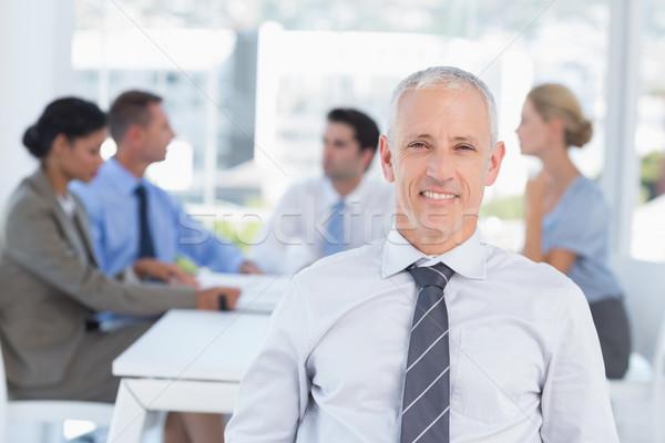 Souriant affaires équipe bureau heureux gens d'affaires Photo stock © wavebreak_media
