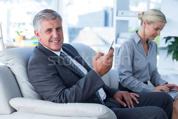 Sorridere imprenditore chiamata segretario laptop Foto d'archivio © wavebreak_media
