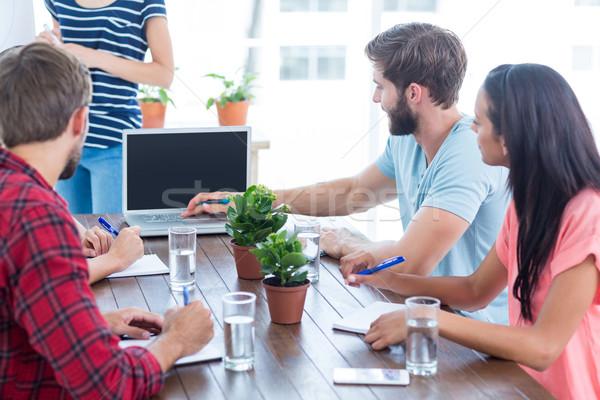 Arkadaşları dizüstü bilgisayar kullanıyorsanız ofis grup genç iş adamları Stok fotoğraf © wavebreak_media
