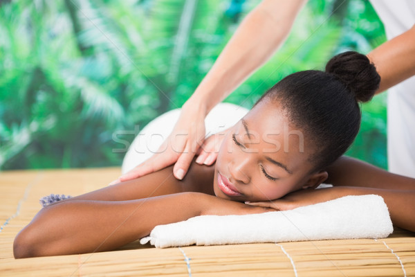 Pretty woman enjoying a back massage Stock photo © wavebreak_media