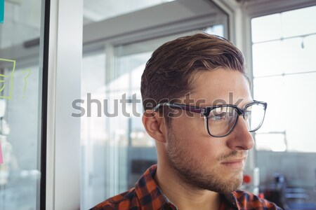 Thoughtful young businessman looking away Stock photo © wavebreak_media