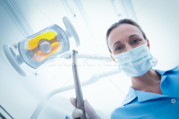 Kobiet dentysta maski chirurgiczne stomatologicznych narzędzie Zdjęcia stock © wavebreak_media