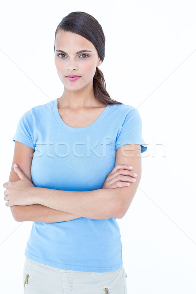 Unsmiling woman looking at camera with arms crossed  Stock photo © wavebreak_media