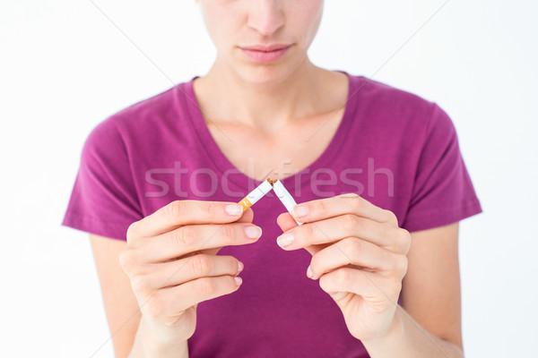 Mujer bonita cigarrillo blanco muerte femenino cute Foto stock © wavebreak_media