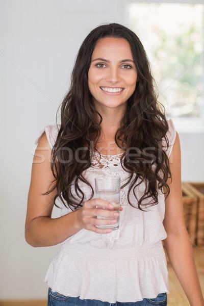 Pretty brunette drinking glass of water Stock photo © wavebreak_media
