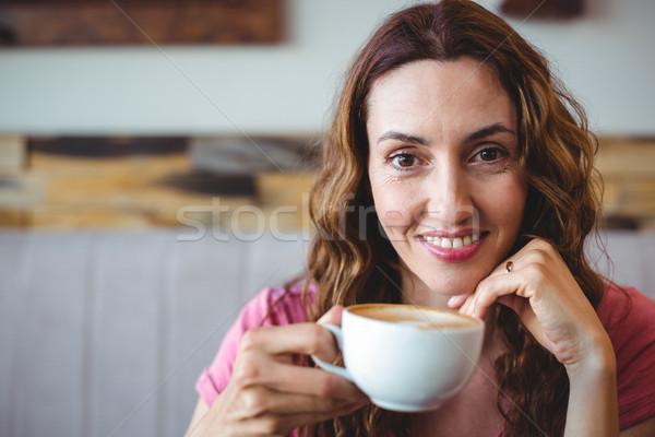 Young woman having a coffee Stock photo © wavebreak_media