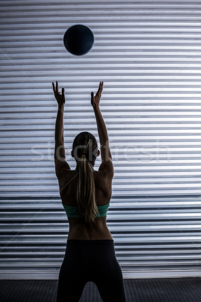Muscular woman throwing ball in the air Stock photo © wavebreak_media