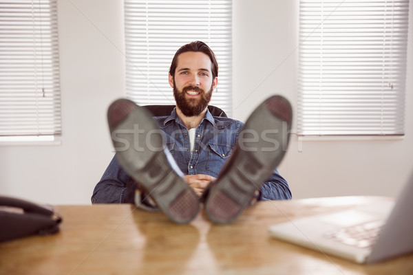 Hipster businessman relaxing at his desk Stock photo © wavebreak_media