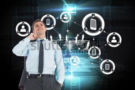 Smiling businessman holding digital tablet Stock photo © wavebreak_media
