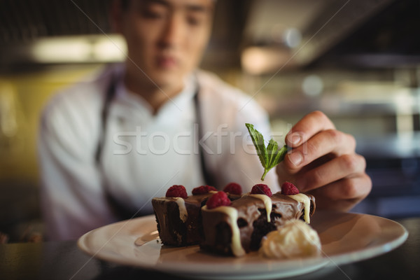 Male chef garnishing dessert plate Stock photo © wavebreak_media