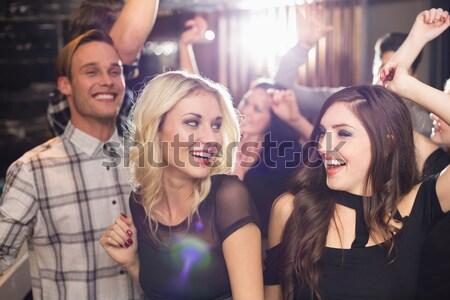 Portré derűs barátok élvezi éjszakai klub zenei fesztivál Stock fotó © wavebreak_media