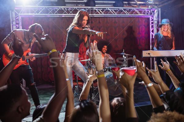 Jóvenes músicos realizar etapa festival de música discoteca Foto stock © wavebreak_media