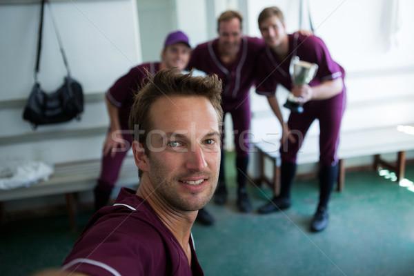портрет улыбаясь бейсбольной команда Постоянный раздевалка Сток-фото © wavebreak_media