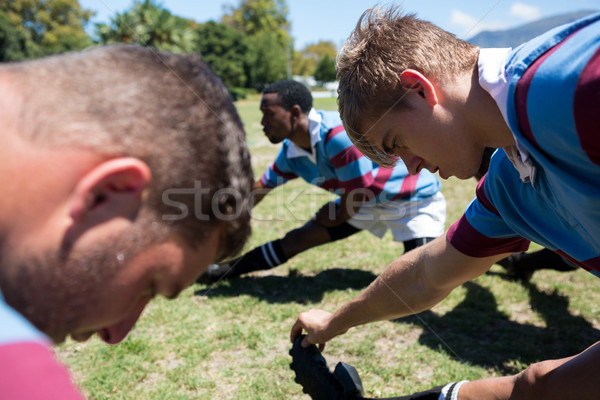 Close up of rugby players stretching at field Stock photo © wavebreak_media