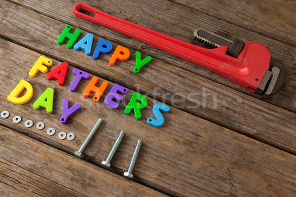 Happy fathers day text and pipe wrench on table Stock photo © wavebreak_media