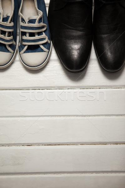 Overhead view of shoes on wooden floor Stock photo © wavebreak_media