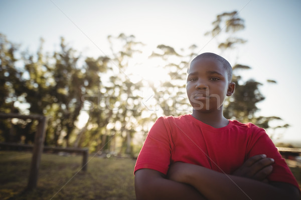 Portrait of boy standing with arms crossed during obstacle course Stock photo © wavebreak_media