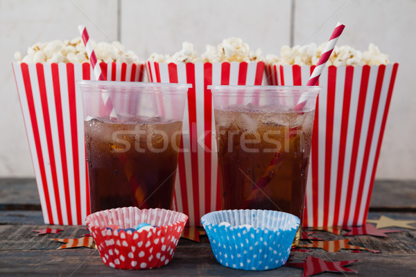 Popcorn, confectionery and drink on wooden table Stock photo © wavebreak_media
