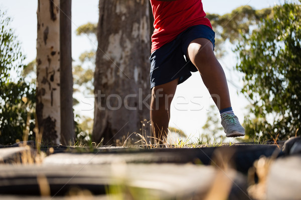Chłopca uruchomiony szkolenia boot obozu Zdjęcia stock © wavebreak_media
