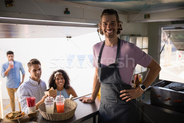Customers and waiter standing at food truck counter Stock photo © wavebreak_media