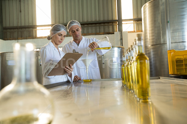 Technicians examining olive oil Stock photo © wavebreak_media
