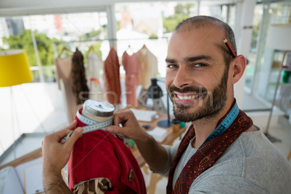 Ritratto sorridere designer giacca mannequin Foto d'archivio © wavebreak_media