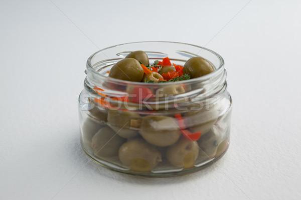 Green olives and herbs in glass jar Stock photo © wavebreak_media