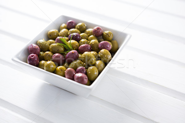 Mariné olives blanche bol table en bois alimentaire Photo stock © wavebreak_media