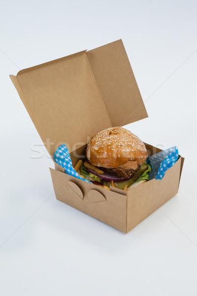 Hamburger z dala pojemnik tabeli biały Zdjęcia stock © wavebreak_media