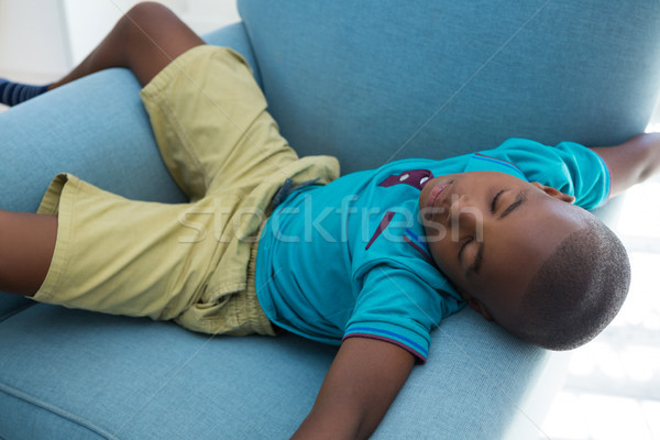High angle view of boy sleeping on blue armchair at home Stock photo © wavebreak_media
