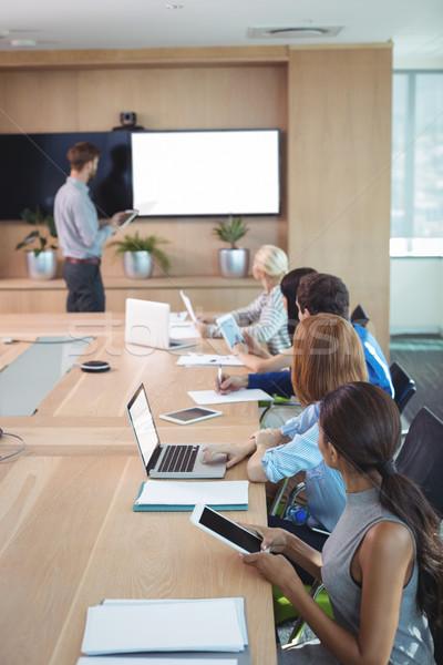 деловые люди используя ноутбук цифровой конференции таблице заседание Сток-фото © wavebreak_media