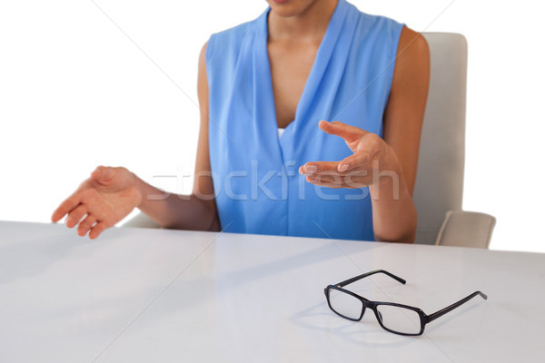 Mid section of businesswoman gesturing while sitting at table Stock photo © wavebreak_media