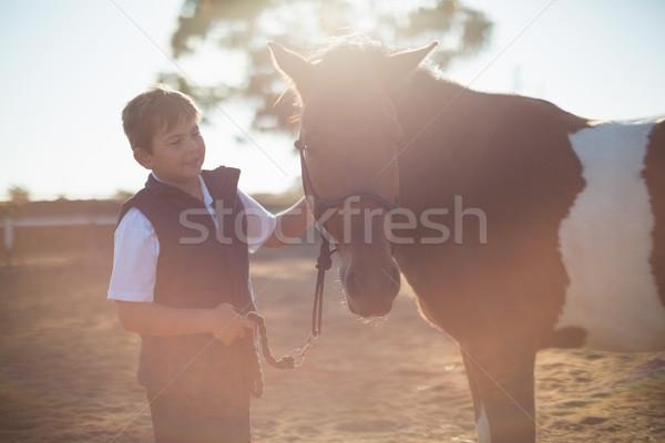 Ragazzo cavallo ranch bambino Foto d'archivio © wavebreak_media